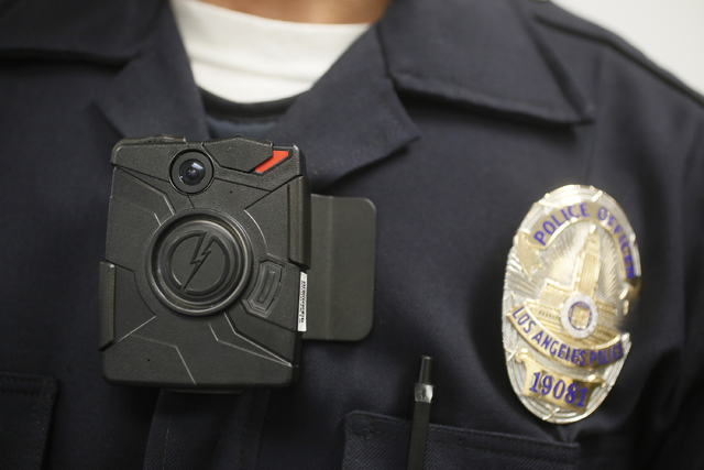 This Jan. 15, 2014 file photo shows a Los Angeles Police officer wearing an on-body cameras during a demonstration for media in Los Angeles. Thousands of police agencies have equipped officers wit ...