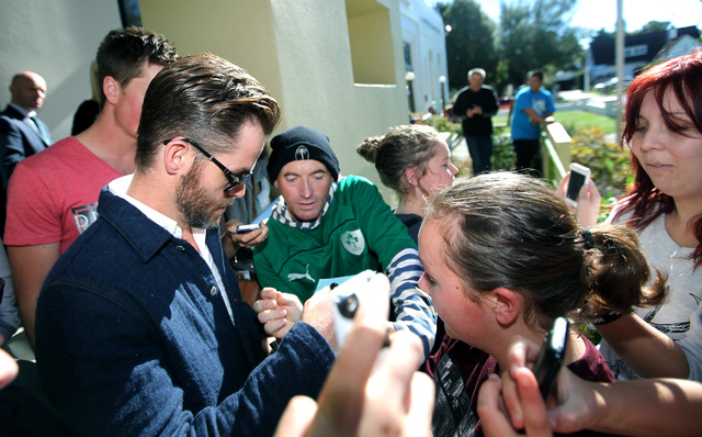 "Hollywood actor Chris Pine, left, is surrounded by people outside a courthouse in Ashburton, New Zealand, Monday, March 17, 2014. Pine, known for playing Captain Kirk in the ""Star Trek"" movies, pl ..."
