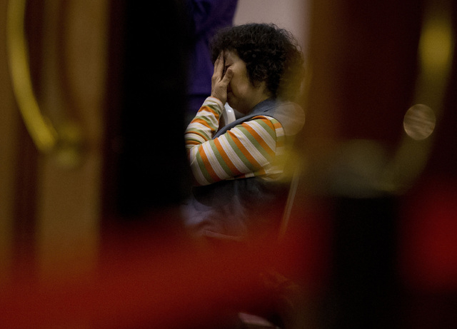 A relative of Chinese passengers aboard the missing Malaysia Airlines Flight MH370 waits for a news briefing by the Airlines' officials at a hotel ballroom in Beijing on Tuesday. Families of the p ...