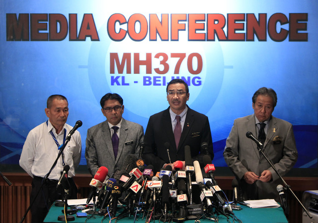 Malaysian acting Transport Minister Hishammuddin Hussein, second from right, speaks as Malaysian Foreign Minister Anifah Aman, right, Malaysia's Department of Civil Aviation director general Azhar ...