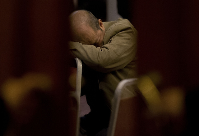 A relative of Chinese passengers aboard the missing Malaysia Airlines Flight MH370 rests on a chair as he waits for a news briefing by the Airlines' officials at a hotel ballroom in Beijing on Tue ...