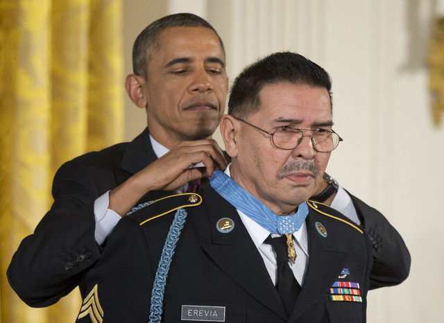 President Barack Obama awards Army Spc. Santiago Erevia the Medal of Honor during a ceremony at the White House on Tuesday. The president awarded the Medals of Honor to 24 ethnic or minority U.S.  ...