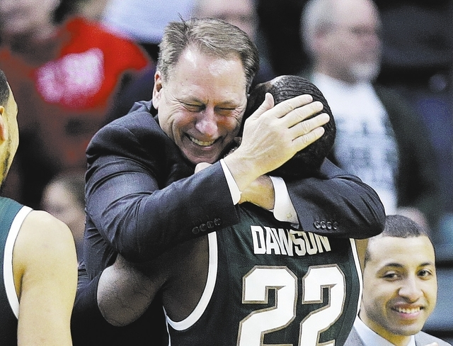 Michigan State coach Tom Izzo hugs Branden Dawson in the closing minutes of the Spartans' 69-55 victory over Michigan on Sunday in the Big Ten tournament final at Indianapolis. Michigan State ha ...