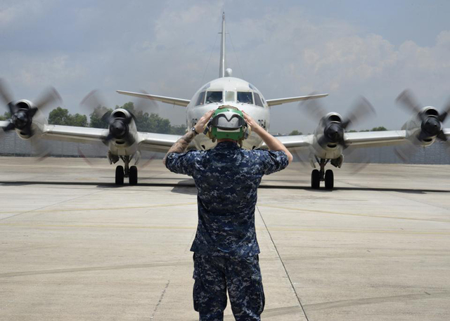 A sailor assigned to Patrol Squadron (VP) 46 prepares to launch a P-3C Orion on Monday before its mission to assist in search and rescue operations for Malaysia Airlines Flight 370 in Kuala Lumpur ...