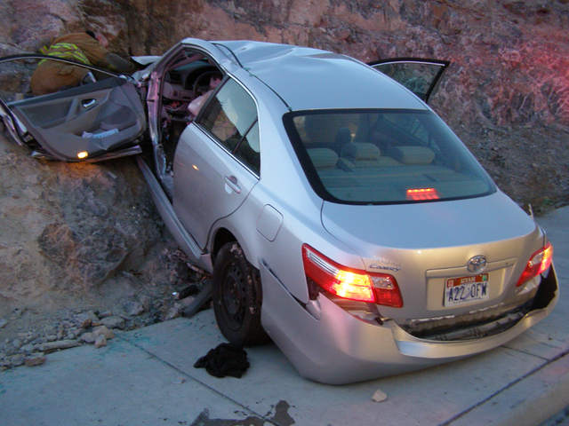 A Toyota Camry is shown after it crashed on Nov. 5, 2010, as it exited Interstate 80 in Wendover, Utah. Police suspect problems with the Camry's accelerator or floor mat caused the crash that left ...
