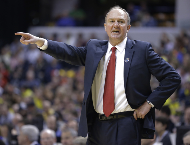 Coach Thad Matta and Ohio State are 6-point favorites today against Dayton, but look for the underdog to put up a fight. Tipoff is 9:15 a.m. (AP Photo/Michael Conroy)