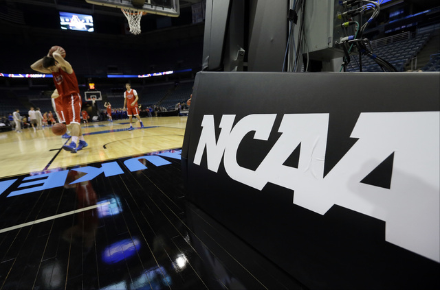 American University players warm up during a practice session for their NCAA college basketball tournament game Wednesday, March 19, 2014, in Milwaukee. American plays Wisconsin in round two on Th ...