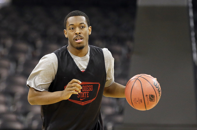 San Diego State's Xavier Thames dribbles during practice for the NCAA college basketball tournament in Spokane, Wash., Wednesday, March 19, 2014. San Diego State plays against New Mexico State in  ...