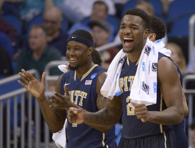 Pittsburgh forwards Jamel Artis (1) and Michael Young (2) celebrate their team's 77-48 victory over Colorado in a second-round game in the NCAA college basketball tournament Thursday, March 20, 20 ...