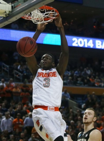 Syracuse's Jerami Grant (3) dunks the ball against Western Michigan during the first half of a second-round game of the NCAA college basketball tournament in Buffalo, N.Y., Thursday, March 20, 201 ...