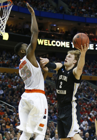 Western Michigan's Connar Tava (2) shoots against Syracuse's Rakeem Christmas (25) during the first half of a second-round game in the NCAA college basketball tournament in Buffalo, N.Y., Thursday ...