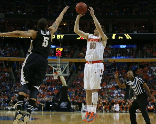 Syracuse's Trevor Cooney (10) puts up a 3-pointer over Western Michigan's David Brown (5) in a second-round game of the NCAA college basketball tournament in Buffalo, N.Y., Thursday, March 20, 201 ...