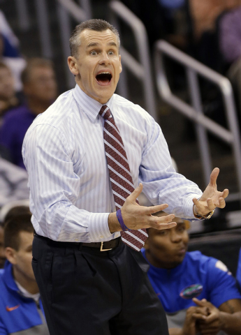Florida coach Billy Donavan gestures to his team during the second half in a second-round game against Albany in the NCAA men's college basketball tournament Thursday, March 20, 2014, in Orlando,  ...