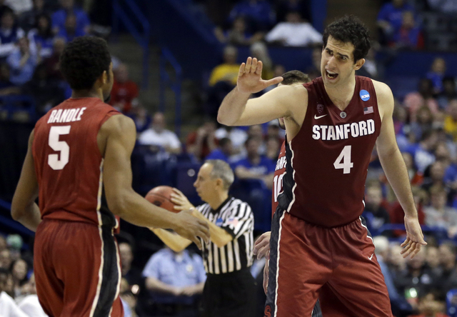 Stanford's Stefan Nastic (4) celebrates with teammate Chasson Randle near the end of  the second half of a second-round game against New Mexico in the NCAA college basketball tournament Friday, Ma ...