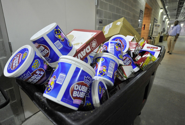 FILE - In this Sunday Oct. 24, 2010, file photo, a garbage bin sits full of bubble gum, at Yankee Stadium, in New York. U.S. gum sales tumbled 11 percent over the past four years. (AP Photo/Kathy  ...