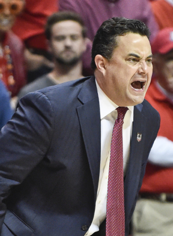 Arizona coach Sean Miller shouts during the first half of a second-round game in the NCAA college basketball tournament against Weber State Friday, March 21, 2014, in San Diego. (AP Photo/Denis Poroy)