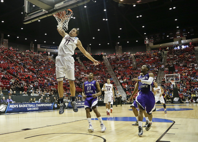 Arizona forward Aaron Gordon slams in a basket against Weber State during the first half in a second-round game in the NCAA college basketball tournament Friday, March 21, 2014, in San Diego. (AP  ...