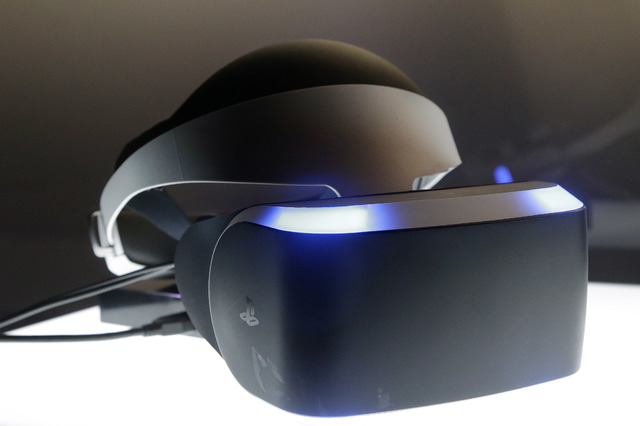 The PlayStation 4 virtual reality headset Project Morpheus is shown in a demo area at the Game Developers Conference 2014 in San Francisco, Wednesday, March 19, 2014.  (AP Photo/Jeff Chiu)