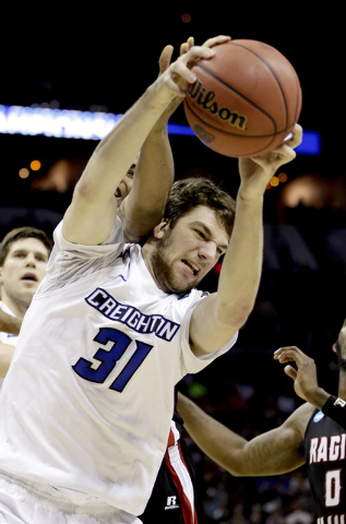 Creighton's Will Artino (31) pulls down a rebound against the Louisiana Lafayette during the second half of a second-round game in the NCAA college basketball tournament Friday, March 21, 2014, in ...