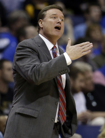 Kansas head coach Bill Self is seen on the sidelines during the first half of a second-round game against Eastern Kentucky in the NCAA college basketball tournament Friday, March 21, 2014, in St.  ...