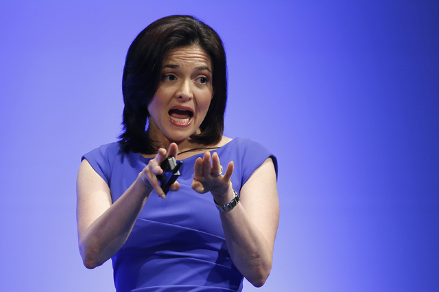 FILE - This July 2, 2013 file photo shows Facebook Chief Operating Officer Sheryl Sandberg speaking during Global Women Leadership Summit in Tokyo. Sandberg and the Girls Scouts recently declared  ...