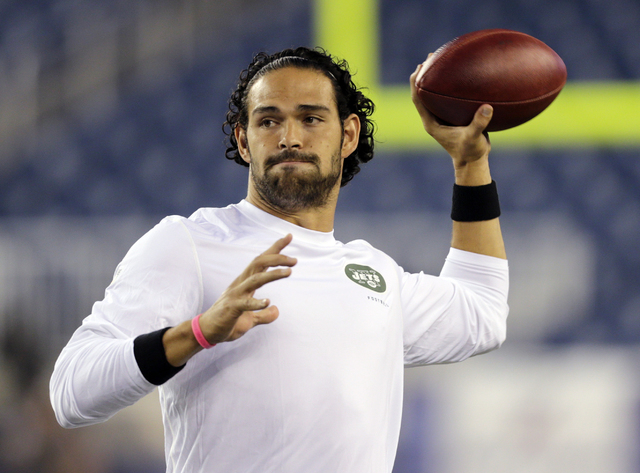 FILE - In a Sept. 12, 2013 filel photo, New York Jets quarterback Mark Sanchez, who normally throws right-handed, throws a pass with his left hang before an NFL football between the New England Pa ...