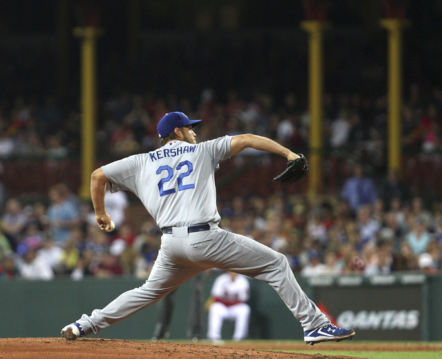 Dodgers' Clayton Kershaw pitches during the the Major League Baseball opening game between the Los Angeles Dodgers and Arizona Diamondbacks at the Sydney Cricket Ground in Sydney, Australia Saturd ...