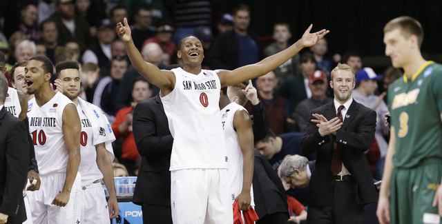 San Diego State's Skylar Spencer (0) celebrates the final seconds in the second half against North Dakota State during the third round of the NCAA men's college basketball tournament in Spokane, W ...