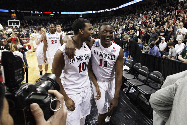 San Diego States Aqeel Quinn (10) and D'Erryl Williams (11) walk off the court after winning against North Dakota State in the second half during the third-round game of the NCAA men's college bas ...