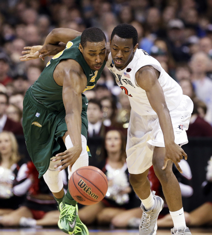 North Dakota State's Kory Brown, left, and San Diego State's Xavier Thames reach for a loose ball in the second half during the third-round of the NCAA men's college basketball tournament in Spoka ...
