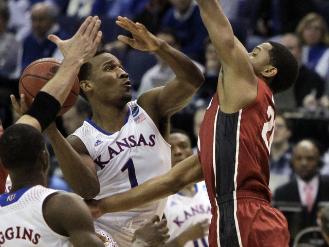 Kansas' Wayne Selden, Jr., left, shoots as Stanford's Anthony Brown defends during the first half of a third-round game of the NCAA college basketball tournament Sunday, March 23, 2014, in St. Lou ...