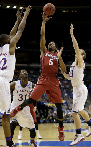 Stanford's Chasson Randle (5) gets between Kansas's Andrew Wiggins, left, Conner Frankamp (23) and k23=, right, to shoot during the first half of a third-round game at the NCAA college basketball  ...