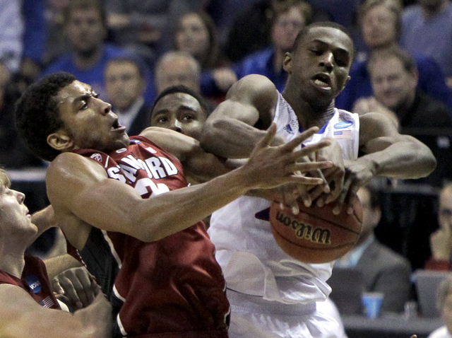 Kansas' Andrew Wiggins, right, and Stanford's Josh Huestis reach for a rebound during the first half of a third-round game of the NCAA college basketball tournament Sunday, March 23, 2014, in St.  ...