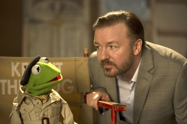 """This image released by Disney shows the muppet character Kermit the frog, left, and Ricky Gervais in a scene from """"Muppets Most Wanted."""" (AP Photo/Disney Enterprises, Inc., Jay Maidment, ..."""