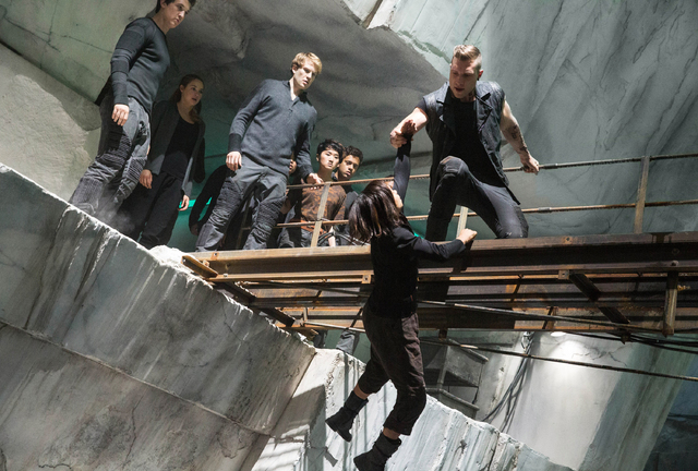 """This photo released by Summit Entertainment shows, from left, Miles Teller, Shailene Woodley, Ben Lamb, Zoe Kravitz, and Jai Courtney, in a scene from the film, """"Divergent."""" The film rel ..."""