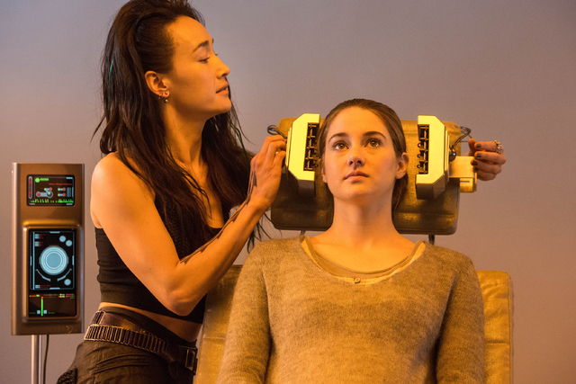 """This photo released by Summit Entertainment, LLC shows Maggie Q, left, as Tori and Shailene Woodley as Beatrice """"Tris"""" Prior, in the film, """"Divergent."""" The film releases Friday ..."""