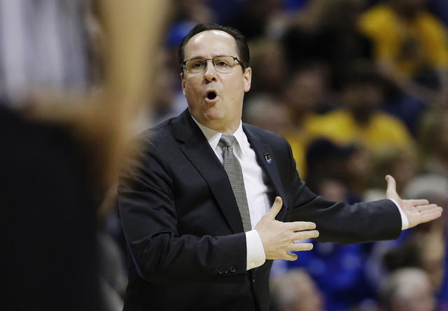Wichita State head coach Gregg Marshall appeals to an official against Kentucky  during the second half of a third-round game of the NCAA college basketball tournament Sunday, March 23, 2014, in S ...