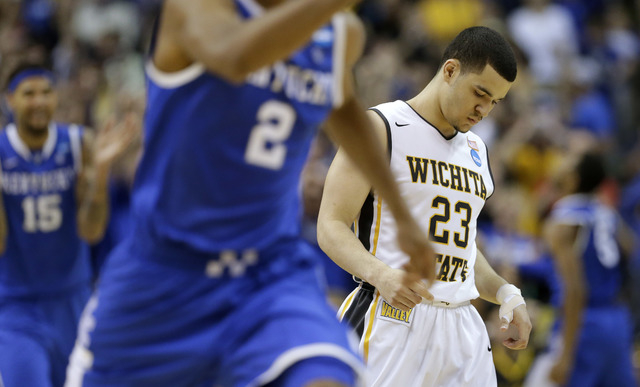 Wichita State guard Fred VanVleet (23) leaves the floor after missing a three-point attempt in the final seconds against Kentucky  during the second half of a third-round game of the NCAA college  ...