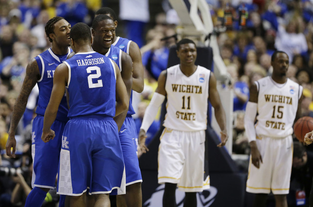 Kentucky players from left, guard/forward James Young (1), guard Aaron Harrison (2) and forward Julius Randle (30) celebrate against Wichita State during the second half of a third-round game of t ...