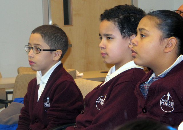 In this Feb. 25, 2014 photo, third-graders, from left, Jan Carlos Medina, Matthew Velez and Natalie Mieses take in a class that teaches them about stroke on Feb. 25, 2014, at Montefiore Hospital i ...