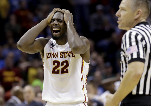 Iowa State's Dustin Hogue (22) reacts after being called for a foul against North Carolina during the second half of a third-round game in the NCAA college basketball tournament Sunday, March 23,  ...