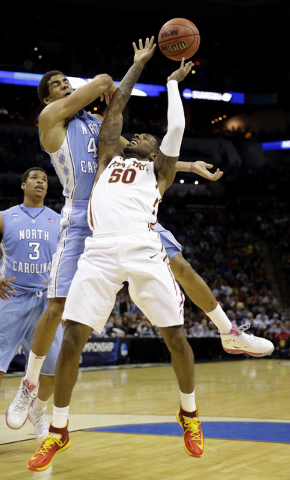 Iowa State's DeAndre Kane (50) shoots as North Carolina's James Michael McAdoo defends during the second half of a third-round game in the NCAA college basketball tournament Sunday, March 23, 2014 ...
