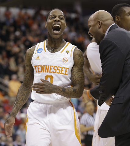 Tennessee guard Antonio Barton (2) celebrates with Tennessee head coach Cuonzo Martin near the the end of the first half of an NCAA college basketball third-round tournament game against Mercer, S ...