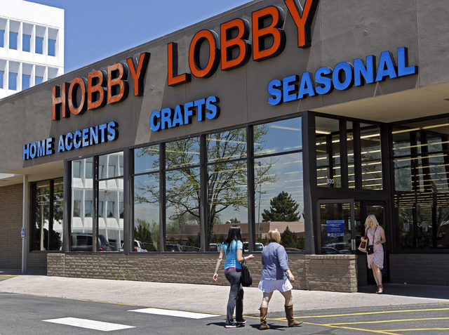 Customers enter and exit a Hobby Lobby store in Denver. The Obama administration and its opponents are renewing the Supreme Court battle over President Barack Obamas health care law in a case that ...