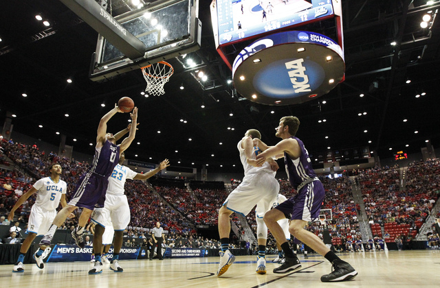 Stephen F. Austin guard Thomas Walkup goes up for a shot against UCLA in a third round game in the NCAA college basketball tournament Sunday, March 23, 2014, in San Diego.  (AP Photo/Gregory Bull )