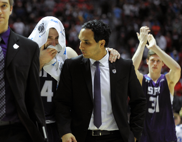 Stephen F. Austin forward Nikola Gajic, left, cries after losing to UCLA in a third-round game of the NCAA college basketball tournament, Sunday, March 23, 2014, in San Diego. UCLA won 77-60. Gaji ...
