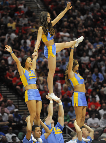 UCLA  cheerleraders during the first half of a third round game in the NCAA college basketball tournament Sunday, March 23, 2014, in San Diego.  (AP Photo/Denis Poroy)