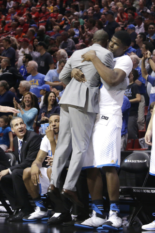 UCLA center Tony Parker picks up Tyus Edney, the UCLA director of basketball operations and former player, in the final seconds during the second half of a third-round game against Stephen F. Aust ...