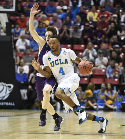 UCLA guard Norman Powell breaks a press by Stephen F. Austin in the second half in a third round game in the NCAA college basketball tournament Sunday, March 23, 2014, in San Diego.  (AP Photo/Den ...