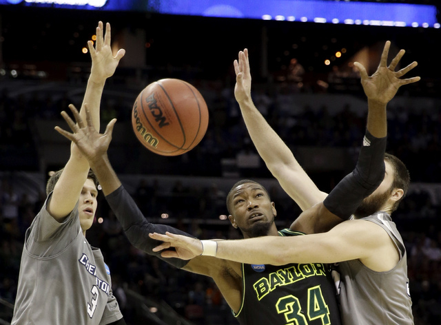 Baylor's Cory Jefferson (34) loses the ball as Creighton's Ethan Wragge, right, and Doug McDermott (3) defend during the second half of a third-round game in the NCAA college basketball tournament ...